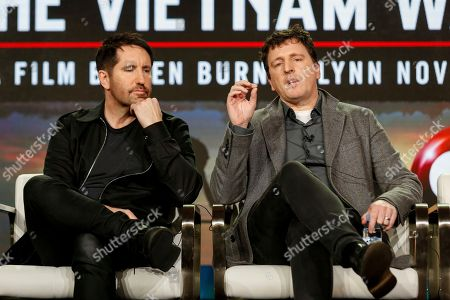 "Trent Reznor, left. and Atticus Ross speak at the PBS's ""The Vietnam War"" panel at the 2017 Television Critics Association press tour, in Pasadena, Calif"