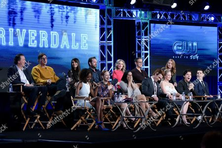 """Jon Goldwater, from left, Roberto Aguirre-Sacasa, Marisol Nichols, Luke Perry, Madchen Amick, Greg Berlanti and Sarah Schechter Front Row, Ashleigh Murray, Madelaine Petsch, Camila Mendes, KJ Apa, Lili Reinhart, Cole Sprouse and Casey Cott attend """"Riverdale"""" panel at The CW portion of the 2017 Winter Television Critics Association press tour, in Pasadena, Calif"""