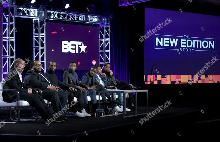 """Executive producer Jesse Collins, from left, director Chris Robinson, Luke James, Woody McClain, Elijah Kelley, Algee Smith and Keith Powers attend """"The New Edition Story"""" panel at Viacom's BET portion of the Winter Television Critics Association press tour, in Pasadena, Calif"""
