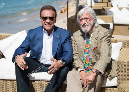Actor Arnold Schwarzenegger, left, and director Jean-Michel Cousteau pose for photographers during the photo call for the film Wonders of the Sea 3D at the 70th international film festival, Cannes, southern France