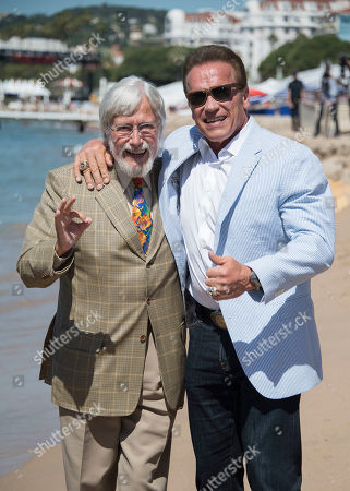 Actor Arnold Schwarzenegger, right, and director Jean-Michel Cousteau pose for photographers during the photo call for the film Wonders of the Sea 3D at the 70th international film festival, Cannes, southern France