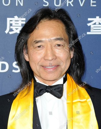 """Stock Image of Jeff Imada, winner of the award for best global action choreography for """"Furious 7"""" poses in the press room at the 21st annual Huading Global Film Awards at The Theatre at Ace Hotel, in Los Angeles"""