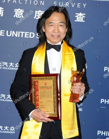 """Stock Picture of Jeff Imada, winner of the award for best global action choreography for """"Furious 7"""" poses in the press room at the 21st annual Huading Global Film Awards at The Theatre at Ace Hotel, in Los Angeles"""