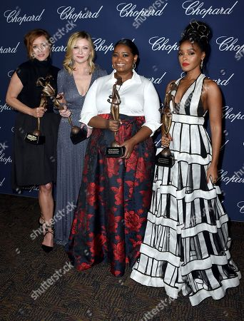 """Members of the cast of """"Hidden Figures"""" Kimberly Quinn, from left, Kirsten Dunst, Octavia Spencer and Janelle Monae pose backstage with the ensemble performance award at the 28th annual Palm Springs International Film Festival Awards Gala, in Palm Springs, Calif"""