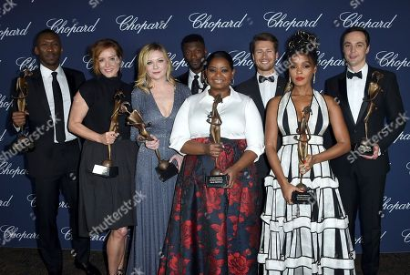 """The cast of """"Hidden Figures"""" pose backstage with the ensemble performance award at the 28th annual Palm Springs International Film Festival Awards Gala, in Palm Springs, Calif. From left are Mahershala Ali, Kimberly Quinn, Kirsten Dunst, Aldis Hodge, Octavia Spencer, Glen Powell, Janelle Monae and Jim Parsons"""