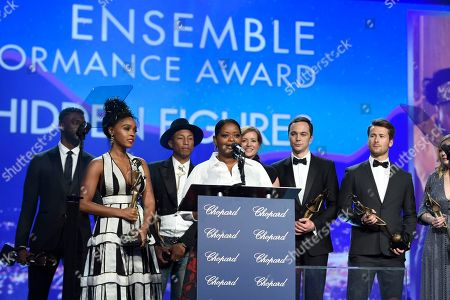 """Octavia Spencer, center, accepts the award for ensemble performance for """"Hidden Figures"""" at the 28th annual Palm Springs International Film Festival Awards Gala, in Palm Springs, Calif. Looking on from background left are Aldis Hodge, Janelle Monae, Pharrell Williams, Kimberly Quinn, Jim Parsons, Glen Powell, and Kirsten Dunst"""