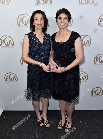 """Laura Ricciardi, left, and Moira Demos accept the award for non-fiction television for """"Making a Murderer"""" at the 28th Annual Producers Guild Awards at the Beverly Hilton, in Beverly Hills, Calif"""