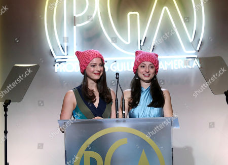 Nora Rothman, left, and Elizabeth Rothman speak at the 28th Annual Producers Guild Awards at the Beverly Hilton, in Beverly Hills, Calif