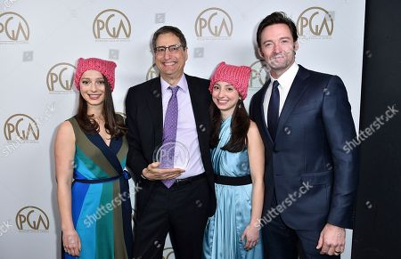 Nora Rothman, from left, Tom Rothman, winner of the milestone award, Elizabeth Rothman, and Hugh Jackman attend the 28th Annual Producers Guild Awards at the Beverly Hilton, in Beverly Hills, Calif