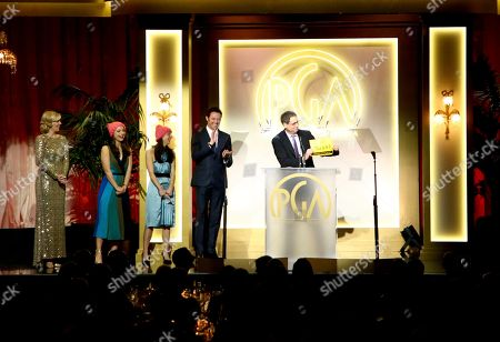 Nora Rothman, from left, Elizabeth Rothman, Hugh Jackman, and Tom Rothman, winner of the milestone award, at the 28th Annual Producers Guild Awards at the Beverly Hilton, in Beverly Hills, Calif
