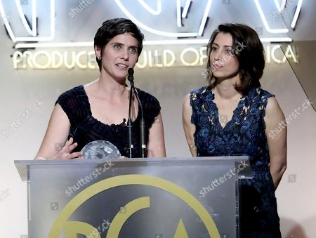 """Moira Demos, left, and Laura Ricciardi accept the award for non-fiction television for """"Making a Murderer"""" at the 28th Annual Producers Guild Awards at the Beverly Hilton, in Beverly Hills, Calif"""