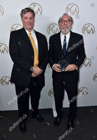 Al Jean, left, presents the Norman Lear achievement award to James L. Brooks at the 28th Annual Producers Guild Awards at the Beverly Hilton, in Beverly Hills, Calif