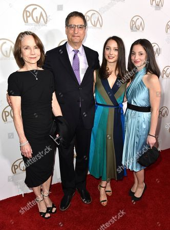 Jessica Harper, from left, Tom Rothman, Elizabeth Rothman, and Nora Rothman arrive at the 28th Annual Producers Guild Awards at the Beverly Hilton, in Beverly Hills, Calif