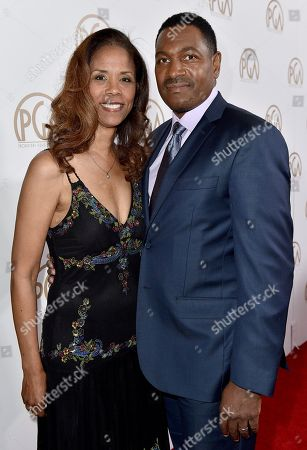 Stock Photo of Sondra Spriggs, left, and Mykelti Williamson arrive at the 28th Annual Producers Guild Awards at the Beverly Hilton, in Beverly Hills, Calif