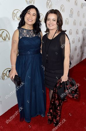 Stock Image of PGA treasurer Christina Lee Storm, left, and Rebecca Graham Forde arrive at the 28th Annual Producers Guild Awards at the Beverly Hilton, in Beverly Hills, Calif