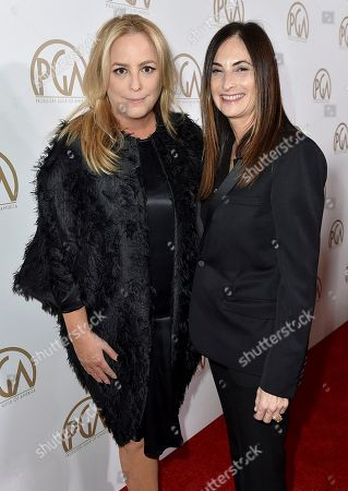 Julie Yorn, left, and Carla Hacken arrive at the 28th Annual Producers Guild Awards at the Beverly Hilton, in Beverly Hills, Calif