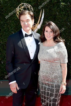 Mehmet Oz, left, and Lisa Oz arrive at the 44th Annual Daytime Emmy Awards at the Pasadena Civic Center, in Pasadena, Calif