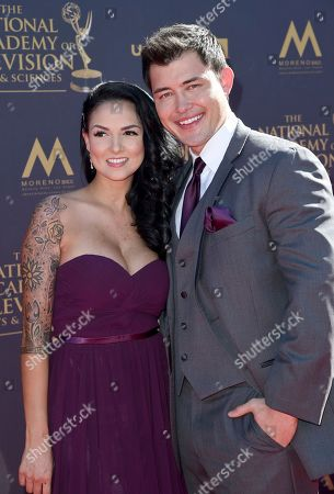 Stock Picture of Laneya Arvizu, left, and Christopher Sean arrive at the 44th Annual Daytime Emmy Awards at the Pasadena Civic Center, in Pasadena, Calif