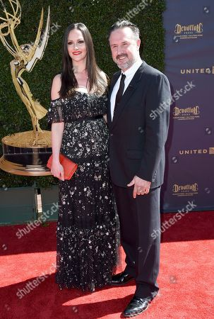 Stock Image of David Arquette, right, and Christina McLarty arrive at the 44th Annual Daytime Emmy Awards at the Pasadena Civic Center, in Pasadena, Calif