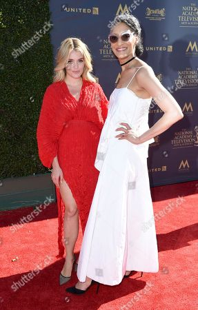 Daphne Oz, left, and Carla Hall arrive at the 44th Annual Daytime Emmy Awards at the Pasadena Civic Center, in Pasadena, Calif