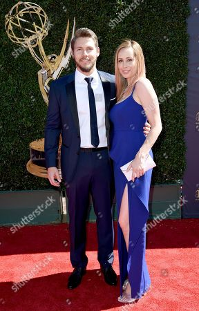 Scott Clifton, left, and Nicole Lampson arrive at the 44th Annual Daytime Emmy Awards at the Pasadena Civic Center, in Pasadena, Calif