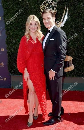 Daphne Oz, left, and Dr. Mehmet Oz arrive at the 44th annual Daytime Emmy Awards at the Pasadena Civic Center, in Pasadena, Calif