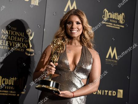"Gaby Natale, winner of the award for outstanding daytime talent in a Spanish language program for ""SuperLatina w/Gaby Natale,"" poses in the press room at the 44th annual Daytime Emmy Awards at the Pasadena Civic Center, in Pasadena, Calif"