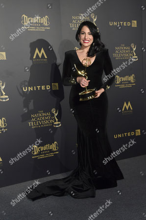 """Alejandra Gutierrez Oraa, winner of the award for outstanding entertainment program in a Spanish language for """"Destines"""", poses in the press room at the 44th annual Daytime Emmy Awards at the Pasadena Civic Center, in Pasadena, Calif"""