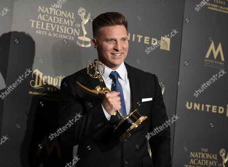 """Steve Burton, winner of the award for supporting actor in a drama series for """"The Young and the Restless"""", poses in the press room at the 44th annual Daytime Emmy Awards at the Pasadena Civic Center, in Pasadena, Calif"""