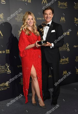 "Daphne Oz, left, and Dr. Mehmet Oz pose in the press room with the award for outstanding informative talk show for ""The Dr. Oz Show"" at the 44th annual Daytime Emmy Awards at the Pasadena Civic Center, in Pasadena, Calif"