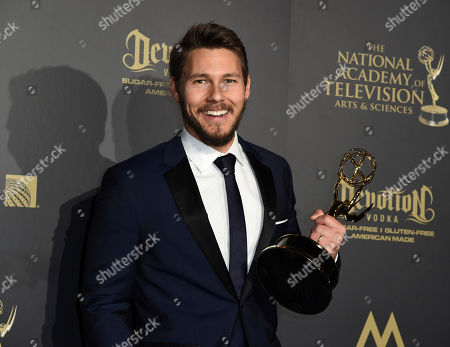 """Scott Clifton, winner of the award for outstanding lead actor in a drama series for """"The Bold and the Beautiful,"""" poses in the press room at the 44th annual Daytime Emmy Awards at the Pasadena Civic Center, in Pasadena, Calif"""