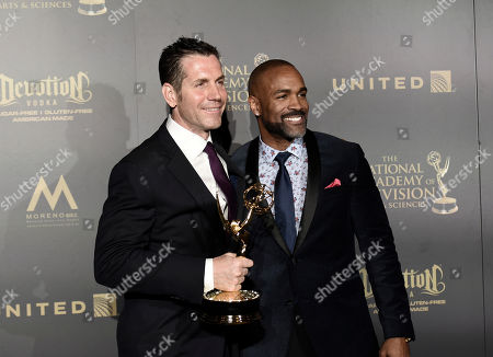 "Frank Valentini, left, and Donnell Turner pose with the award for outstanding drama series for ""General Hospital"" in the press room at the 44th annual Daytime Emmy Awards at the Pasadena Civic Center, in Pasadena, Calif"