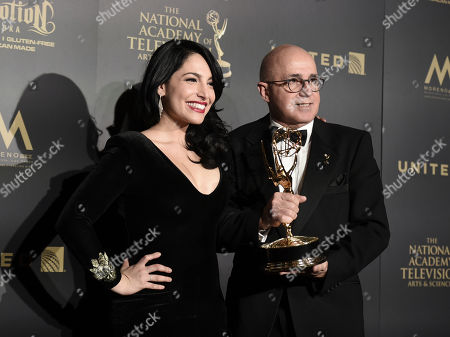 "Alejandra Oraa, left, and Eduardo Suarez, winners of the award for outstanding entertainment program in Spanish language program for ""Destinos,"" pose in the press room at the 44th annual Daytime Emmy Awards at the Pasadena Civic Center, in Pasadena, Calif"