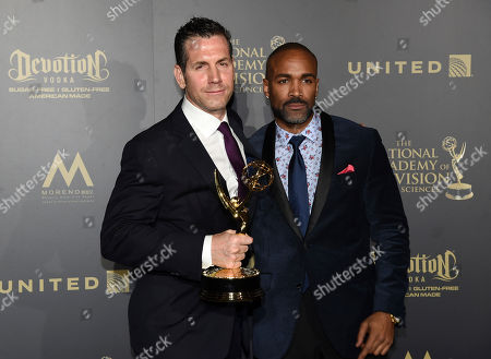 "Frank Valentini, left, and Donnell Turner, winners of the award for outstanding drama series for ""General Hospital"", pose in the press room at the 44th annual Daytime Emmy Awards at the Pasadena Civic Center, in Pasadena, Calif"