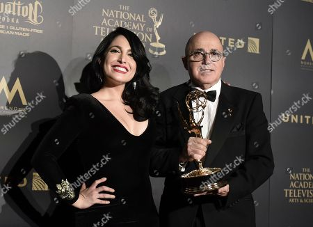 "Alejandra Gutierrez Oraa, left, and Eduardo Suarez, winners of the award for outstanding entertainment program in Spanish language program for ""Destinos,"" pose in the press room at the 44th annual Daytime Emmy Awards at the Pasadena Civic Center, in Pasadena, Calif"