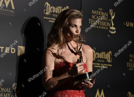 """Gina Tognoni, winner of the award for outstanding lead actress in a drama series for """"The Young and the Restless,"""" poses in the press room at the 44th annual Daytime Emmy Awards at the Pasadena Civic Center, in Pasadena, Calif"""