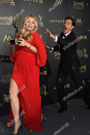 "Daphne Oz, left, jokingly steals the award for outstanding informative talk show for ""The Dr. Oz Show"" from her father, Dr. Mehmet Oz, right, at the 44th annual Daytime Emmy Awards at the Pasadena Civic Center, in Pasadena, Calif"