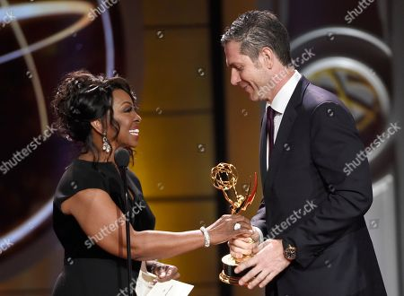 "Stock Image of Gladys Knight, left, presents Frank Valentini with the award for outstanding drama series for ""General Hospital"" at the 44th annual Daytime Emmy Awards at the Pasadena Civic Center, in Pasadena, Calif"