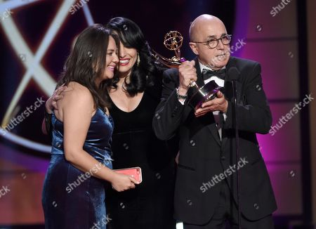 "Natali Monterrosa, from left, Alejandra Gutierrez Oraa, and Eduardo Suarez accept the award for outstanding entertainment program in Spanish language program for ""Destinos"" at the 44th annual Daytime Emmy Awards at the Pasadena Civic Center, in Pasadena, Calif"