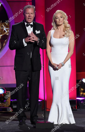 Chris Hansen, left, and Erika Jane stand on stage at the 44th annual Daytime Emmy Awards at the Pasadena Civic Center, in Pasadena, Calif