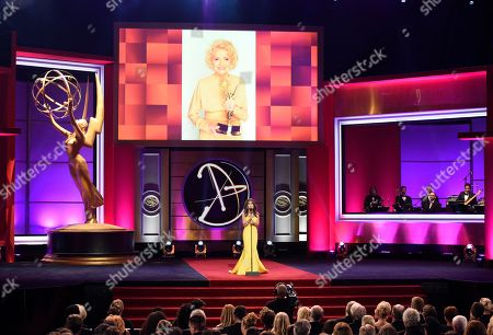 Susan Lucci speaks on stage in tribute to Agnes Nixon at the 44th annual Daytime Emmy Awards at the Pasadena Civic Center, in Pasadena, Calif