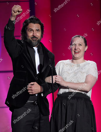 Stock Picture of Jeffrey Vincent Parise, left, and Stephanie Reichert speak on stage at the 44th annual Daytime Emmy Awards at the Pasadena Civic Center, in Pasadena, Calif