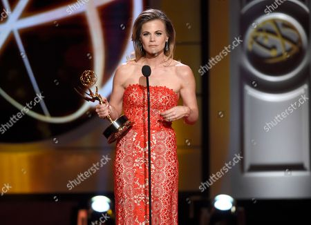 """Gina Tognoni accepts the award for outstanding lead actress in a drama series for """"The Young and the Restless"""" at the 44th annual Daytime Emmy Awards at the Pasadena Civic Center, in Pasadena, Calif"""