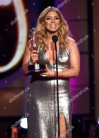 "Gaby Natale accepts the award for daytime talent in a Spanish language program for ""SuperLatina w/Gaby Natale"" at the 44th annual Daytime Emmy Awards at the Pasadena Civic Center, in Pasadena, Calif"