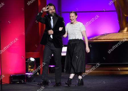 Jeffrey Vincent Parise, left, and Stephanie Reichert walk out on stage at the 44th annual Daytime Emmy Awards at the Pasadena Civic Center, in Pasadena, Calif