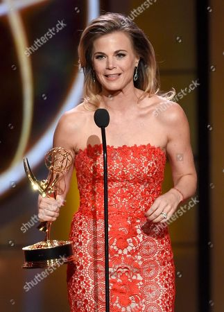 """Stock Image of Gina Tognoni accepts the award for outstanding lead actress in a drama series for """"The Young and the Restless"""" at the 44th annual Daytime Emmy Awards at the Pasadena Civic Center, in Pasadena, Calif"""