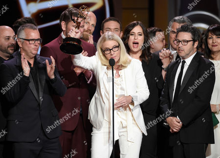 """Mary Connelly, center, accepts the award for outstanding entertainment talk show for """"The Ellen DeGeneres Show"""" at the 44th annual Daytime Emmy Awards at the Pasadena Civic Center, in Pasadena, Calif"""
