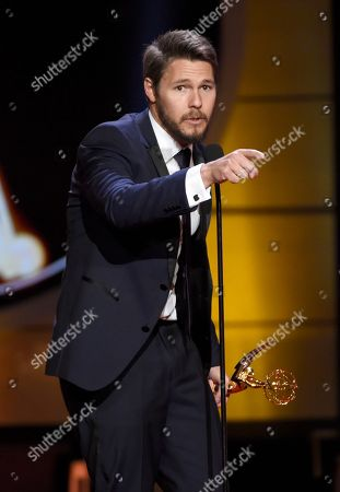 """Scott Clifton accepts the award for outstanding lead actor in a drama series for """"The Bold and the Beautiful"""" at the 44th annual Daytime Emmy Awards at the Pasadena Civic Center, in Pasadena, Calif"""