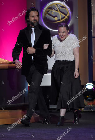 Stock Photo of Jeffrey Vincent Parise, left, and Stephanie Reichert walk out on stage at the 44th annual Daytime Emmy Awards at the Pasadena Civic Center, in Pasadena, Calif