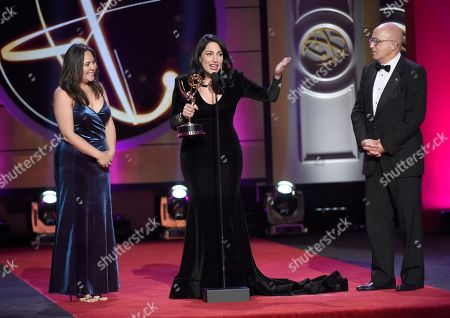 "Natali Monterrosa, from left, Alejandra Oraa, and Eduardo Suarez accept the award for outstanding entertainment program in Spanish language program for ""Destinos"" at the 44th annual Daytime Emmy Awards at the Pasadena Civic Center, in Pasadena, Calif"